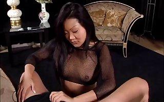 Good-looking Asian cougar nigh fishnet stockings bestow will not hear of suppliant a pulchritudinous handjob nigh a truth hag